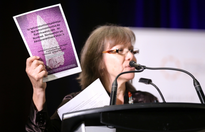 Ellen Gabriel holds a copy of the Kanien'kehá:ka (Mohawk) language version of the UN Declaration on the Rights of Indigenous Peoples at the Truth and Reconciliation Commission of Canada's Closing Events June 1, 2015. CFSC provided financial support for the translation and printing of the Kanien'kehá:ka verison of the UN Declaration. Photo credit: Ben Powless