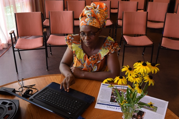Parfaite Ntahuba, Coordinator of AGLI sponsored Friends Women's Association in Burundi prepares before giving a talk at Friends House in Toronto